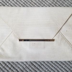 BCBGMAXAZRIA cream snake envelope clutch